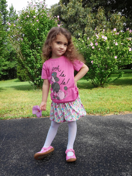 Photo of a girl in the kids' pink shoes
