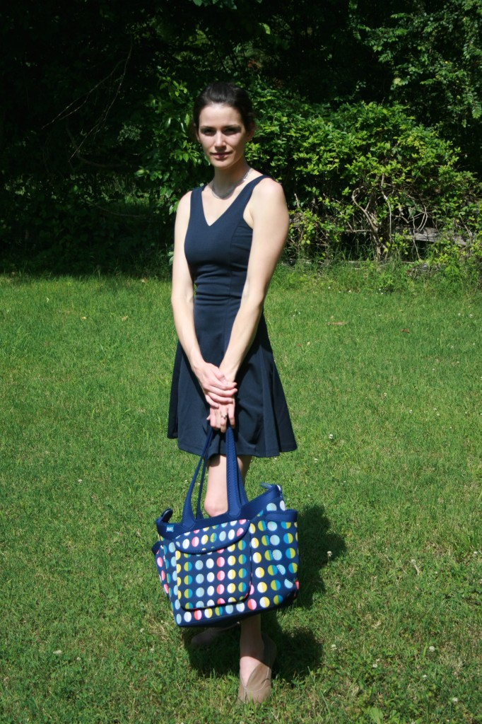 Photo of a woman holding the BuiltNY diaper tote.