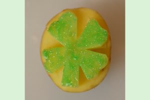 Children can make a festive St. Patrick's Day card or banner using a DIY 4 leaf clover potato stamp.