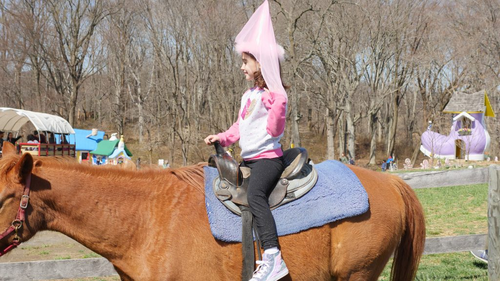 Riding a pony is one of the magical parts of having a birthday party at Clark's Elioak Farm.