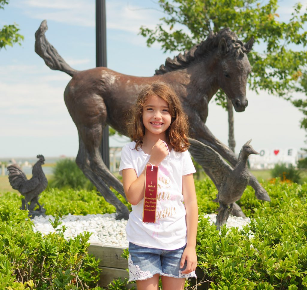 I rode a pony at Chincoteague Pony Centre ribbon in downtown Chincoteague