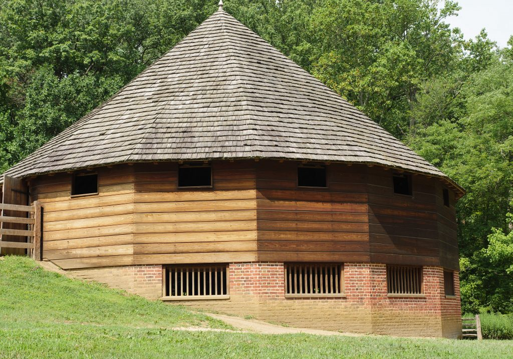You can visit a replica of the 16-sided barn at George Washington's Mount Vernon Estate.