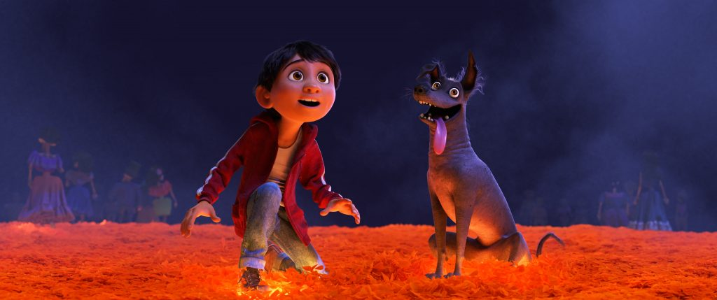 """MARIGOLD BRIDGE — In Disney•Pixar's """"Coco,""""Miguel (voice of newcomer Anthony Gonzalez) desperately wants to prove hismusicaltalent. But when he strums the guitar ofhis idol, the late Ernesto de la Cruz, Miguel sets off a mysterious chain of events and finds himself—and his loyal dog Dante—crossing into the Land of the Dead via a breathtaking bridgemadeof marigoldpetals.Directed by Lee Unkrich, co-directed by Adrian Molina and produced by Darla K. Anderson, """"Coco"""" opens in theaters Nov. 22, 2017. ©2017 Disney•Pixar. All Rights Reserved."""