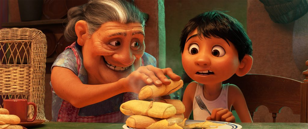 """MORE TAMALES -- In Disney•Pixar's """"Coco,"""" Abuelita—Miguel's loving grandmother—runs the Rivera household like Mamá Imelda did two generations before her. Their philosophy is simple: Work in the family shoemaking business, eat more tamales and, most importantly, """"No music!"""" Featuring the voices of Renée Victor as Abuelita and Anthony Gonzalez as Miguel, Disney•Pixar's """"Coco"""" opens in U.S. theaters on Nov. 22, 2017. ©2017 Disney•Pixar. All Rights Reserved."""