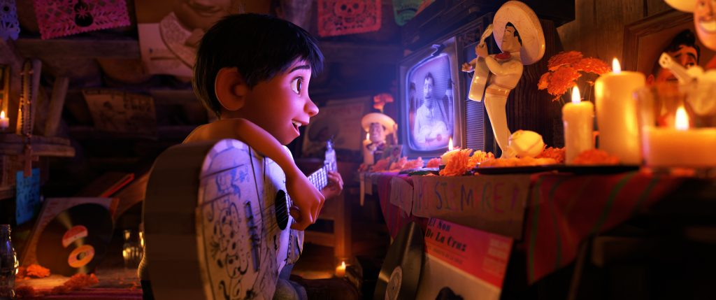 """HIDDEN TALENT -- In Disney•Pixar's """"Coco,"""" Miguel (voice of newcomer Anthony Gonzalez), whostruggles against his family's generations-old ban on music, creates a secret space where he can play his guitar and soak up the on-screen talent of his idol, Ernesto de la Cruz (voice of Benjamin Bratt). Directed by Lee Unkrich (""""Toy Story 3""""), co-directed by Adrian Molina (story artist """"Monsters University"""") and produced by Darla K. Anderson (""""Toy Story 3""""), Disney•Pixar's""""Coco"""" opens in U.S. theaters on Nov. 22, 2017. ©2017 Disney•Pixar. All Rights Reserved."""