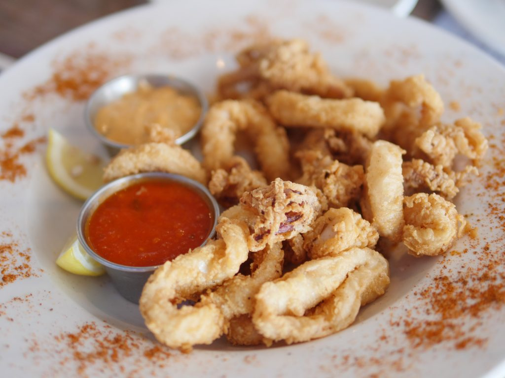 Fresh, hand cut and panko fried Calamari served with herbed marinara sauce and a zesty remoulade at Hudson Coastal Raw Bar & Grille - Theresa's Reviews