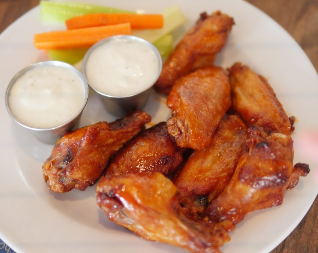 1 lb of Chicken Wings brined, baked, and lightly fried with a traditional wing sauce at Hudson Coastal Raw Bar & Grille - Theresa's Reviews